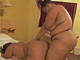 Horny Black Bbw Sucks On Her Lovers Strap On